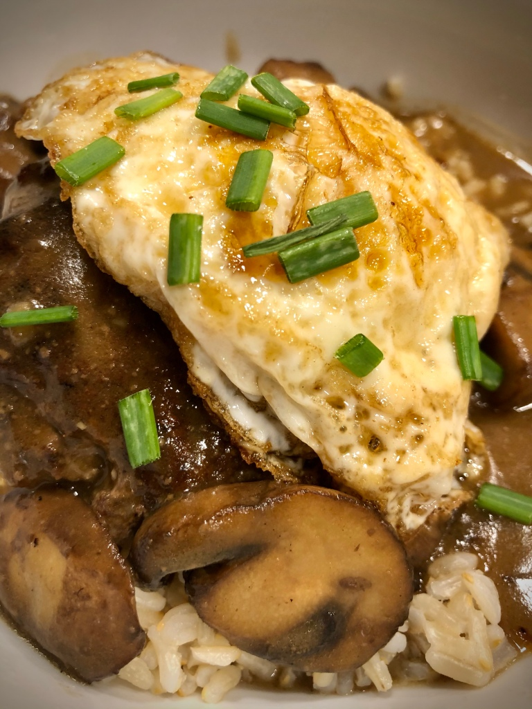 Loco Moco—hamburger patty on a bed of rice, topped with mushroom gravy and a fried egg