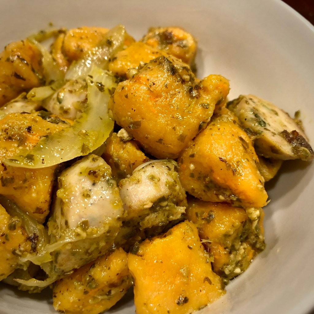 Sweet Potato Gnocchi served with chicken sausage, onions, and a pesto sauce