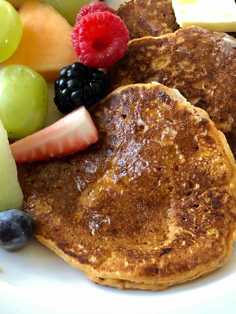Sweet Potato Pancakes served with cut fruit
