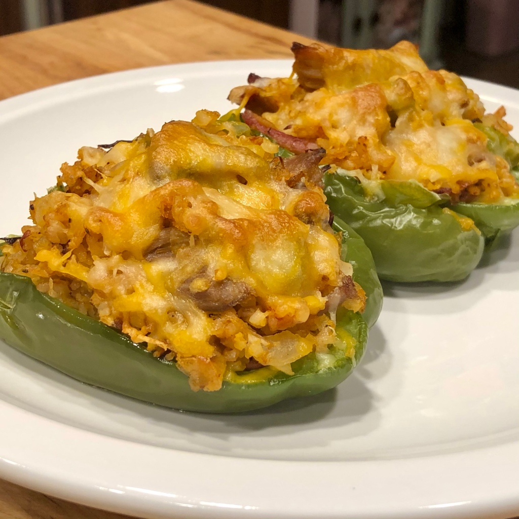 Two BBQ Pork Stuffed Peppers on a plate